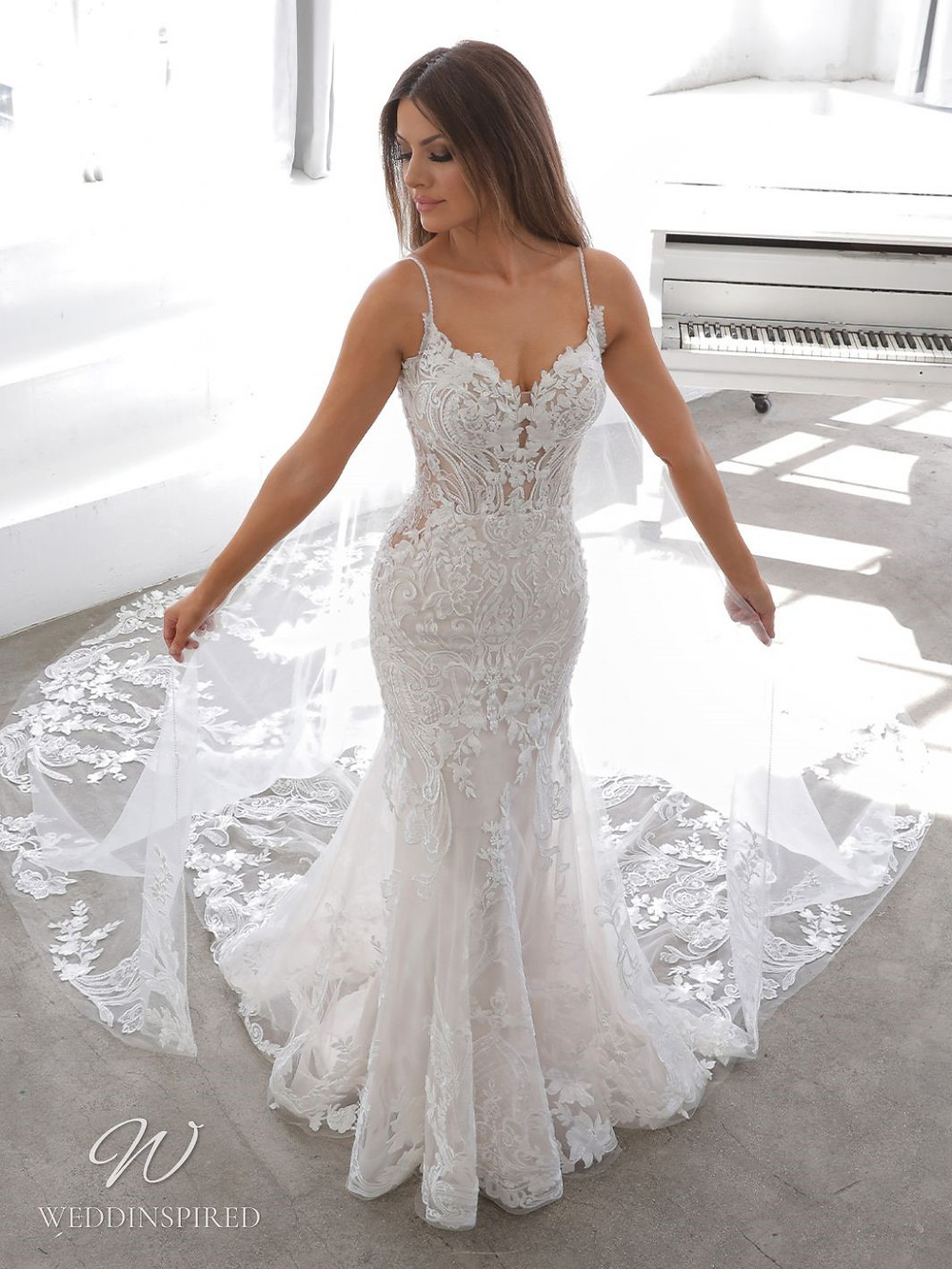 A Blue by Enzoani 2021 lace mermaid wedding dress with straps and v neck