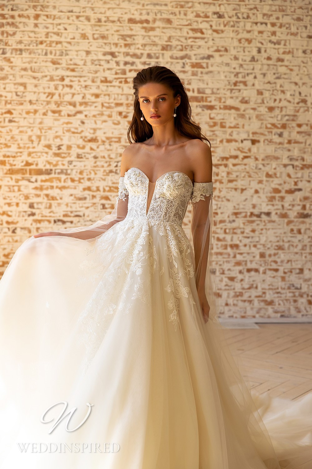 A WONÁ Concept 2021 ivory tulle and lace off the shoulder A-line wedding dress
