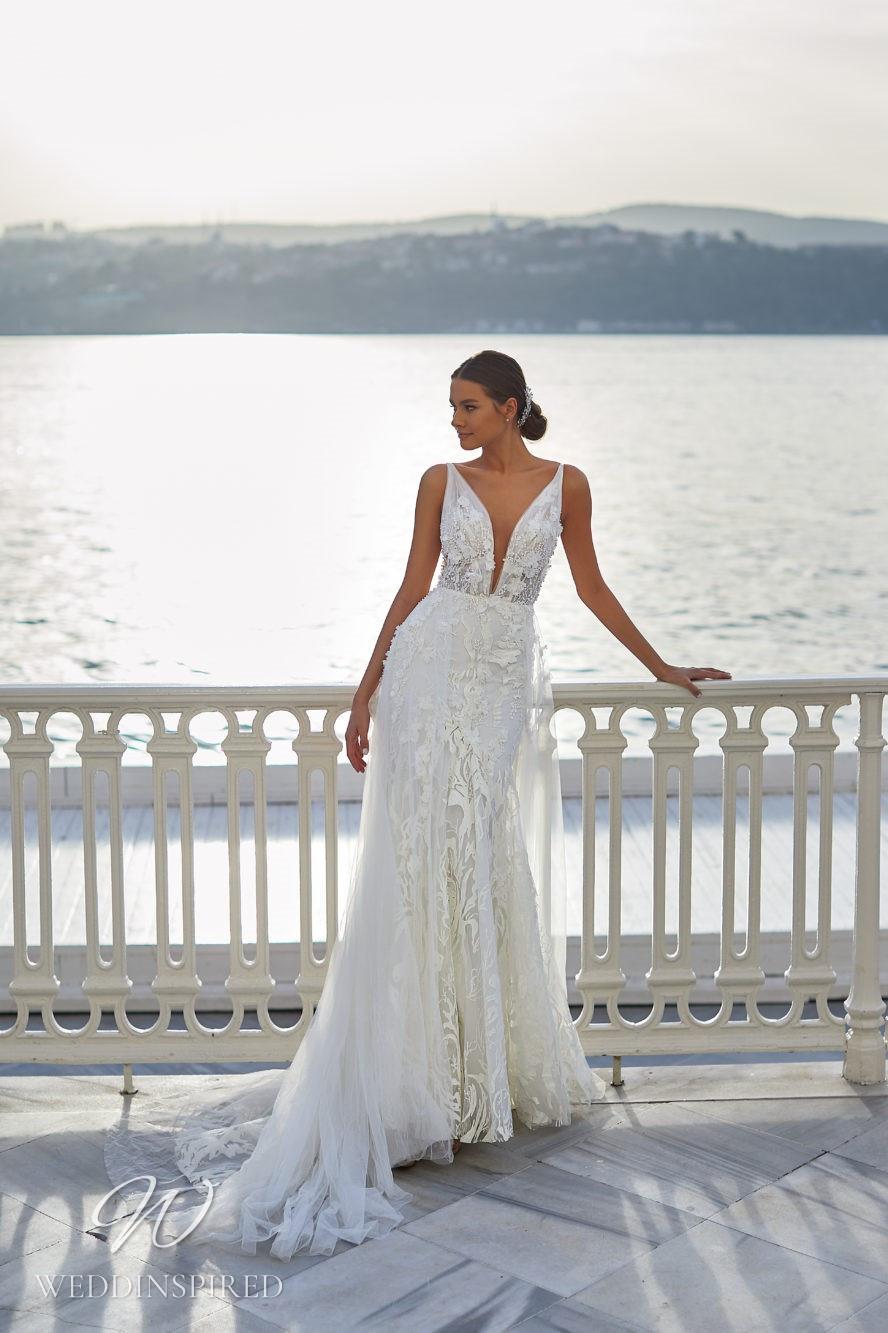 A Milla Nova 2021 lace mermaid wedding dress with straps and a v necj