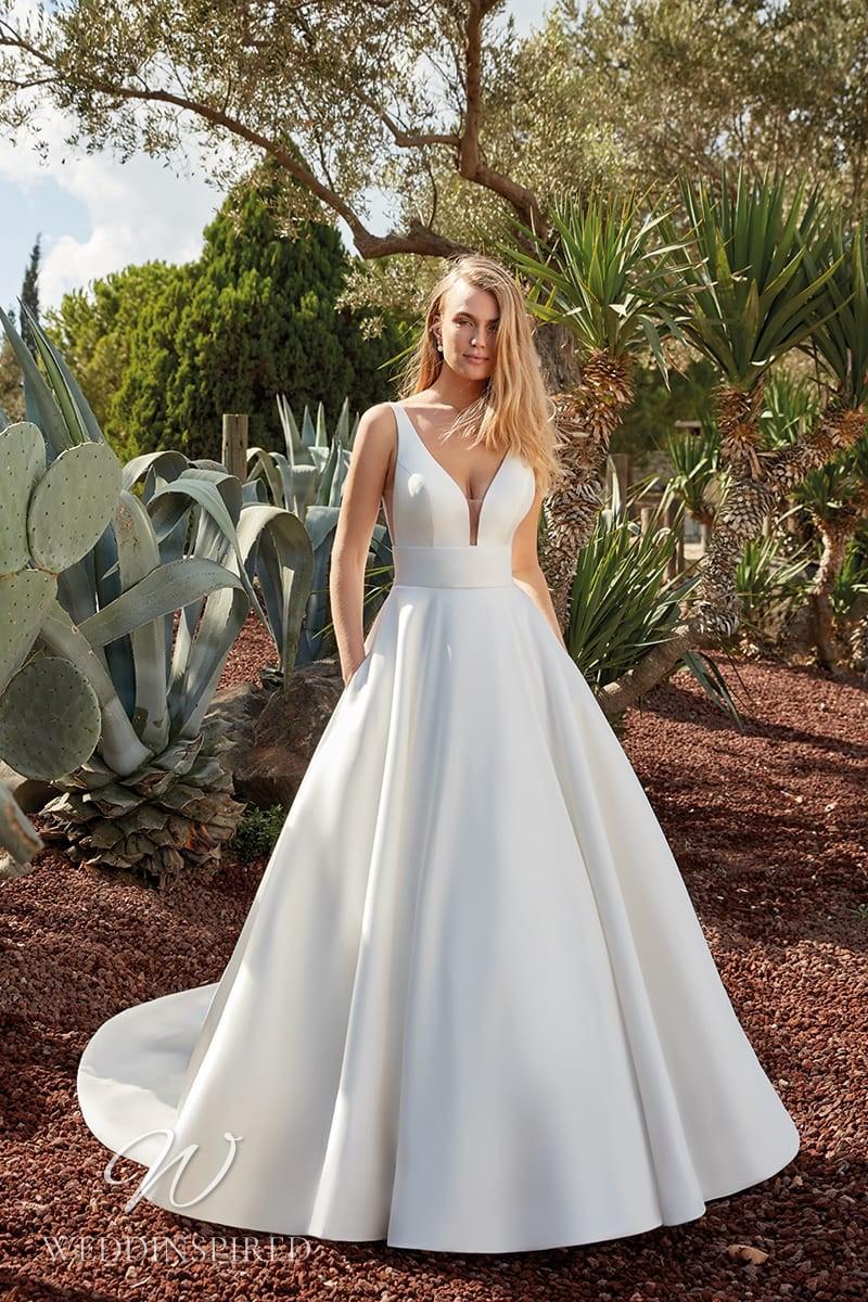 An Eddy K 2022 satin princess wedding dress with pockets