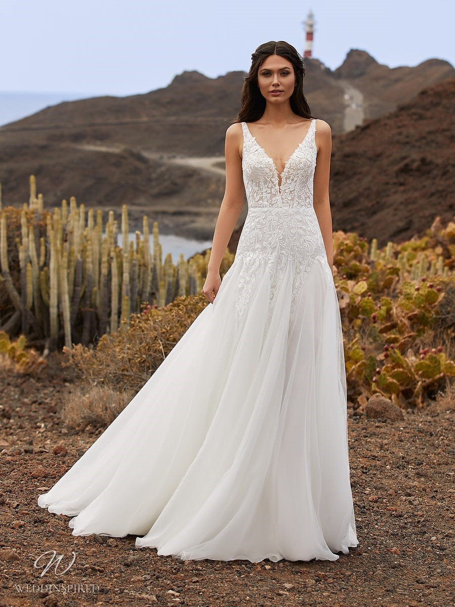 A Pronovias 2021 lace and tulle A-line wedding dress with straps and a v neckline