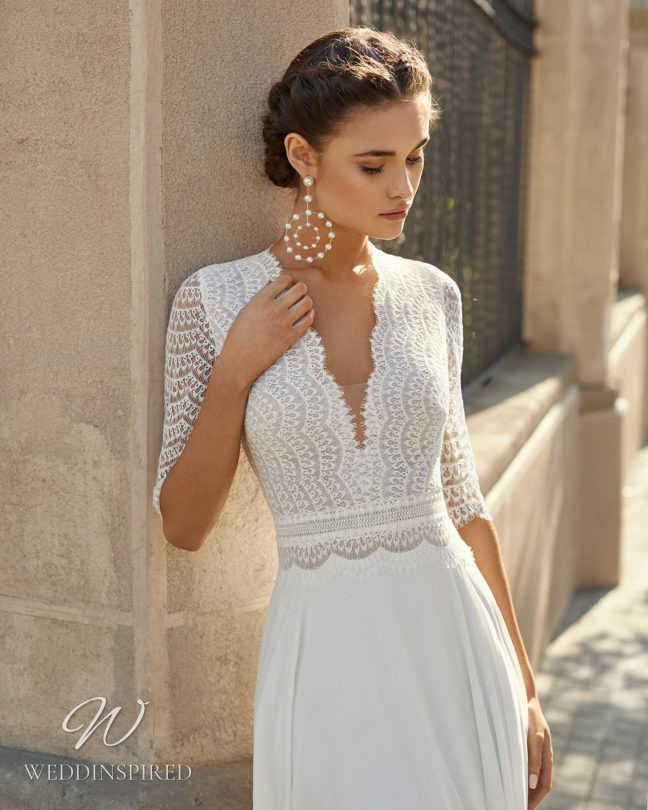An Aire Barcelona 2021 lace and crepe sheath wedding dress with a v neck and half sleeves