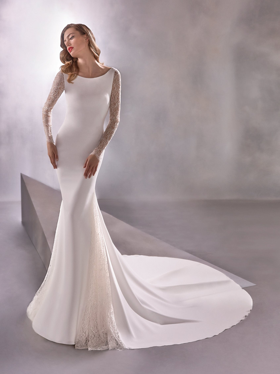 An Atelier Pronovias silk and lace mermaid wedding dress with long lace sleeves and a train