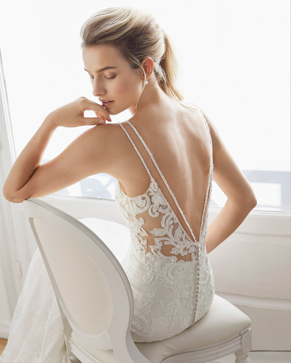 An Aire Barcelona 2020 sparkly lace fitted mermaid wedding dress with a sexy low back