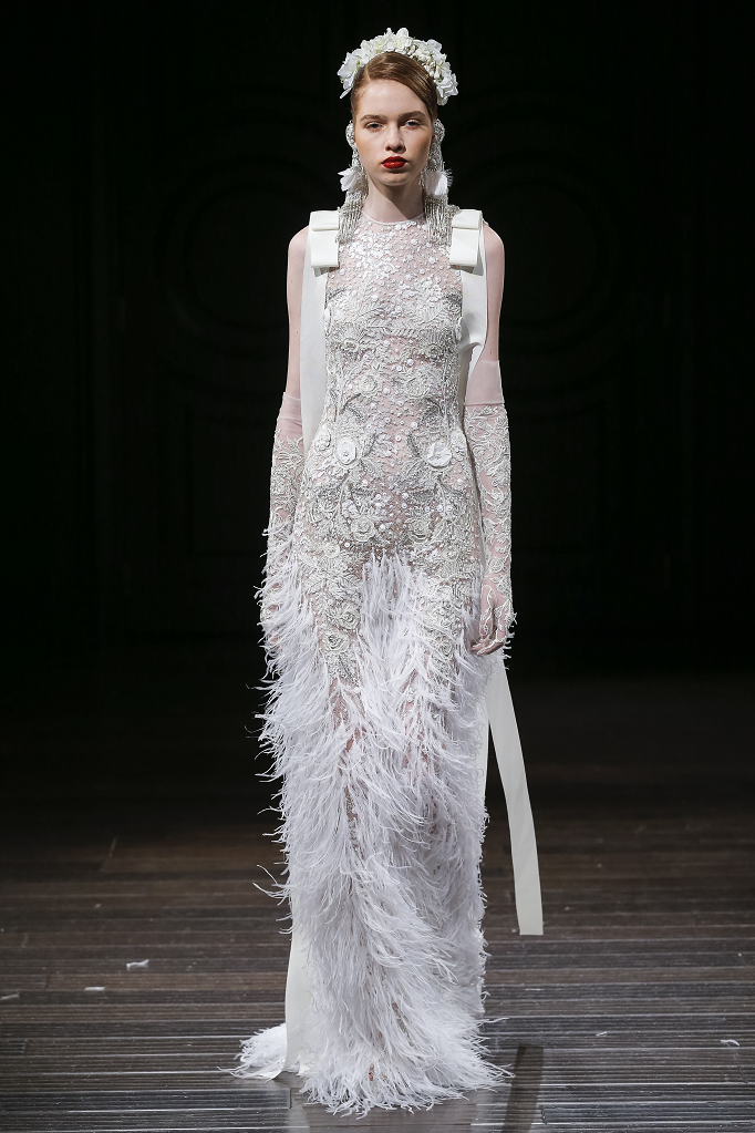 A Naeem Khan fitted lace and feather wedding dress