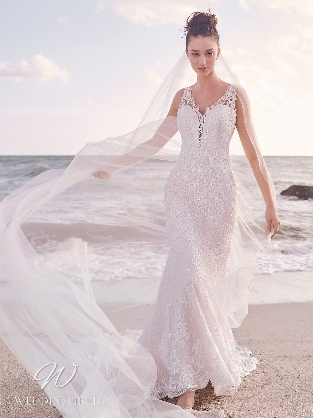 A Sottero & Midgley Spring 2021 white lace mermaid wedding dress with a v neck and straps