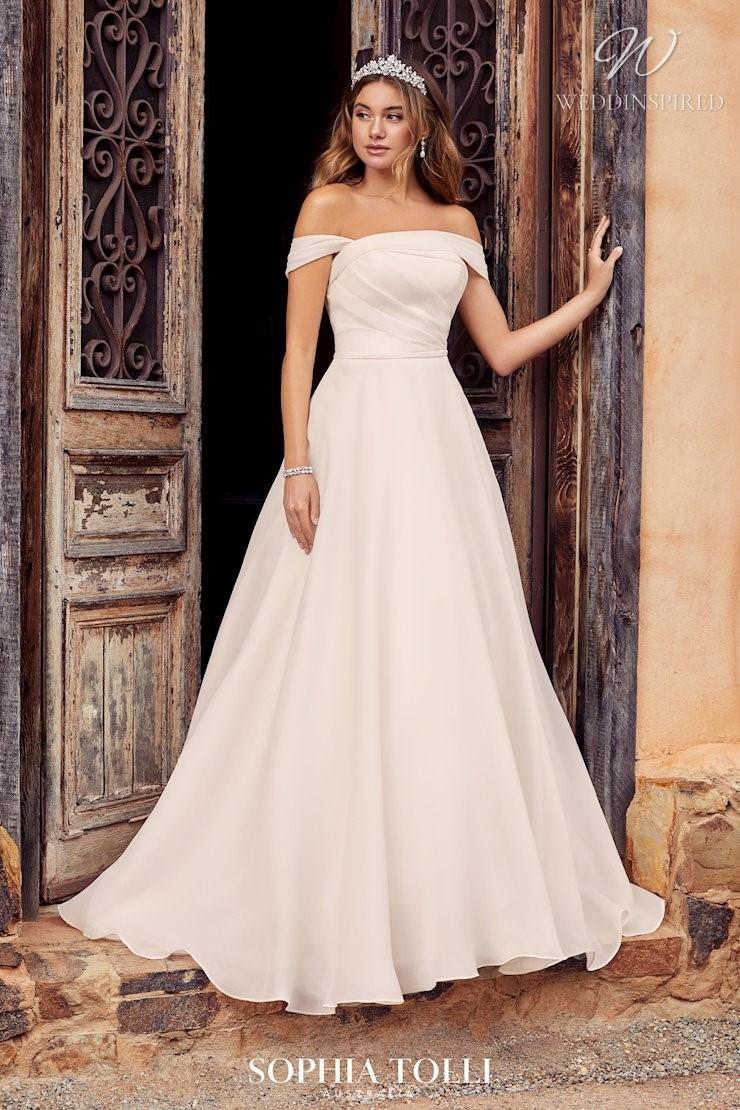 A Sophia Tolli blush chiffon off the shoulder A-line wedding dress