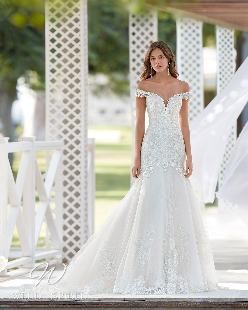 An Aire Barcelona 2021 off the shoulder lace mermaid wedding dress