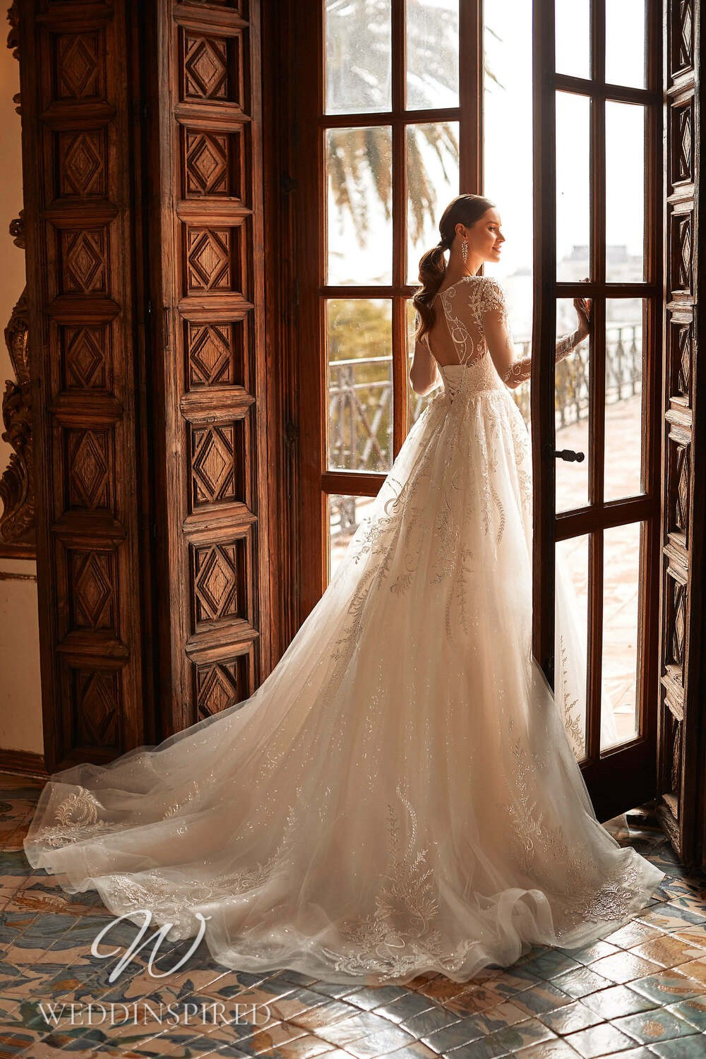 A Royal by Naviblue 2021 lace and tulle princess wedding dress with long sleeves