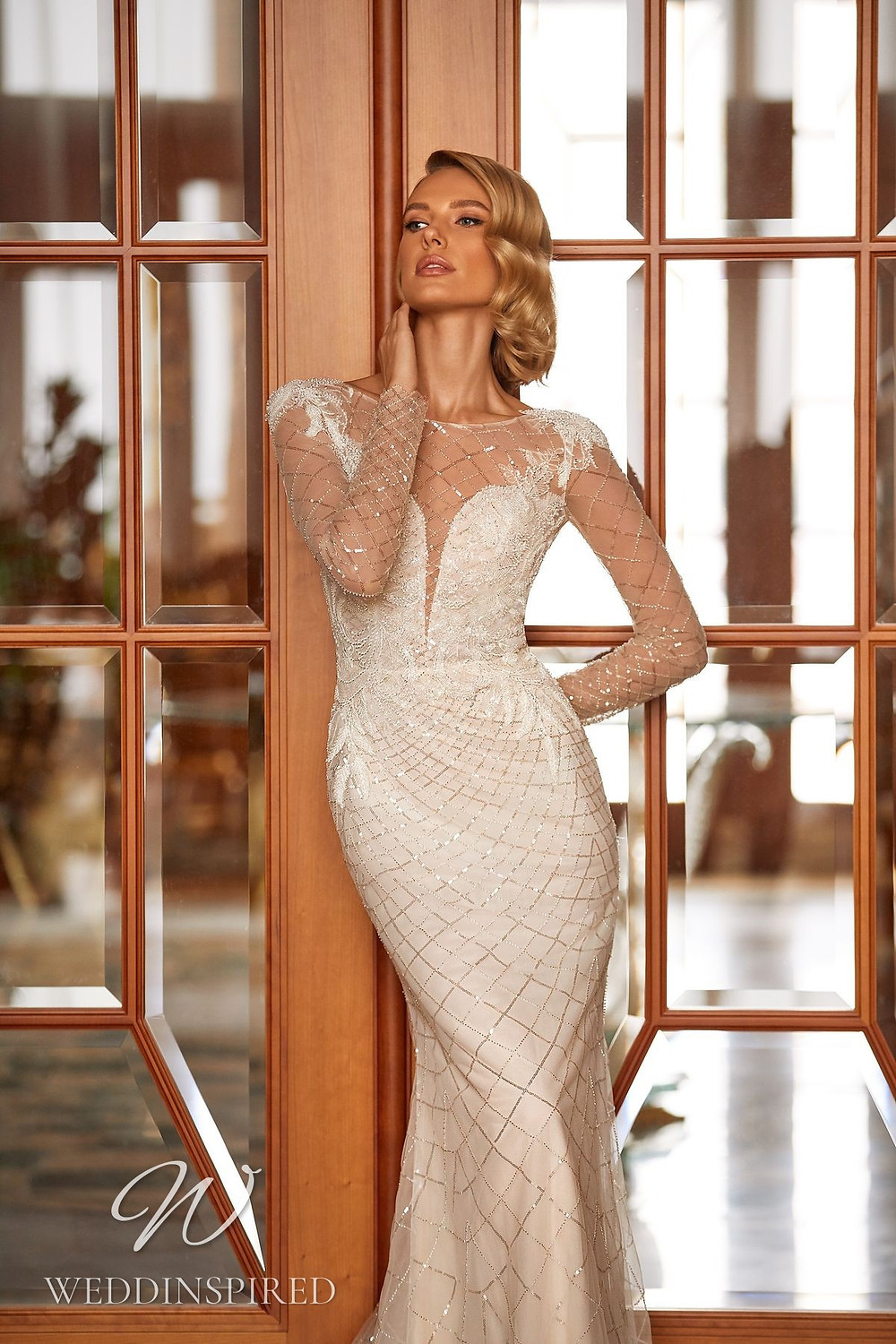 A Pollardi 2021 lace and tulle mermaid wedding dress with long sleeves