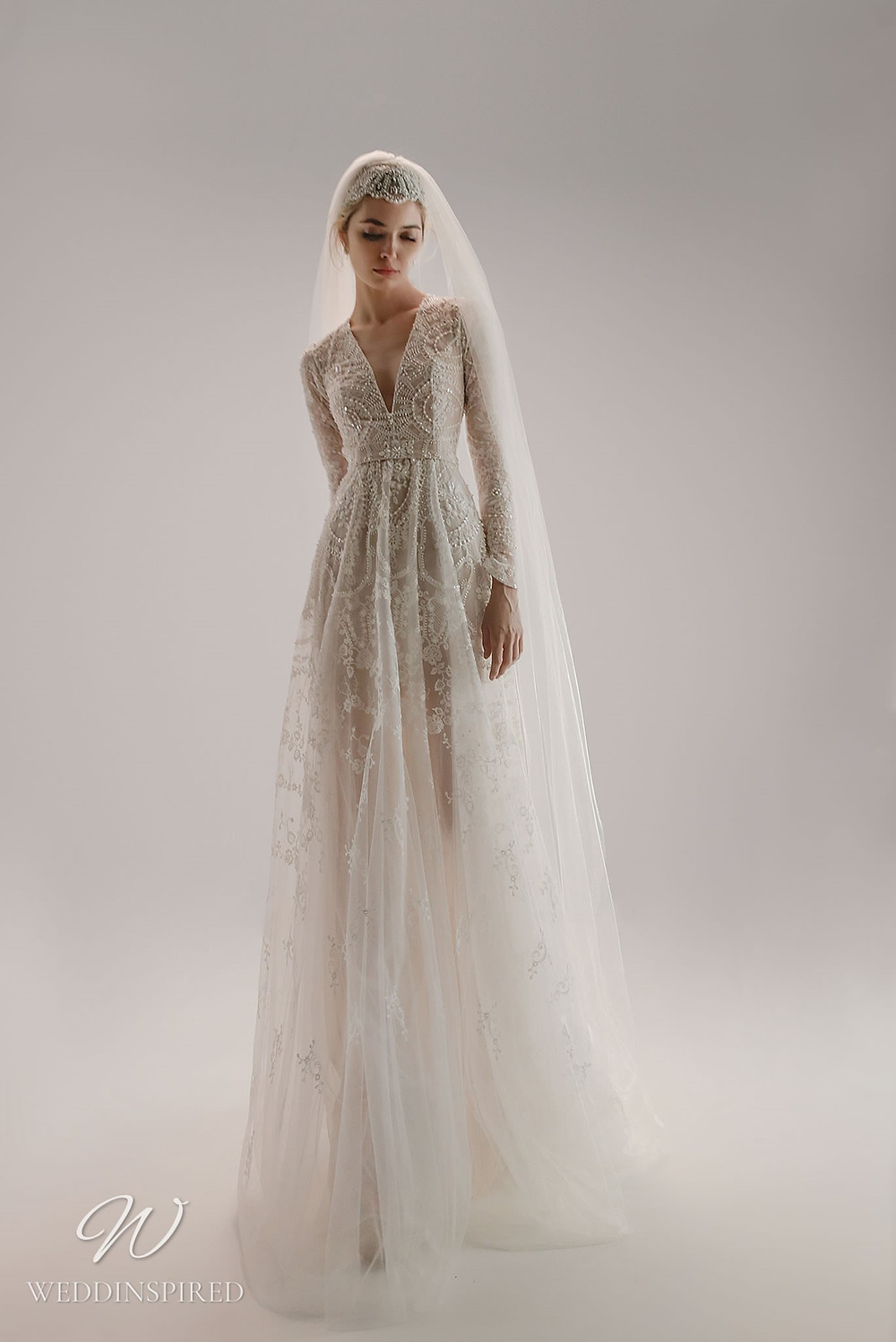 An Ersa Atelier 2021 tulle A-line wedding dress with beading, a v neck and long sleeves