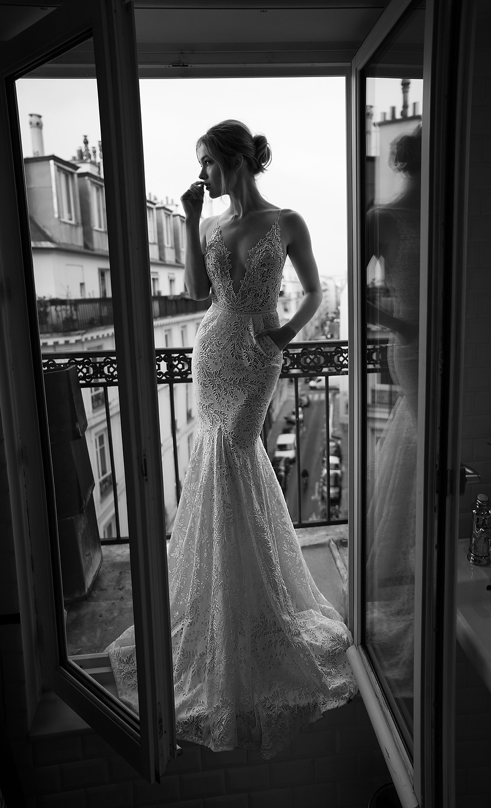 An Inbal Dror sexy lace mermaid wedding dress with pockets, a low v neckline and straps