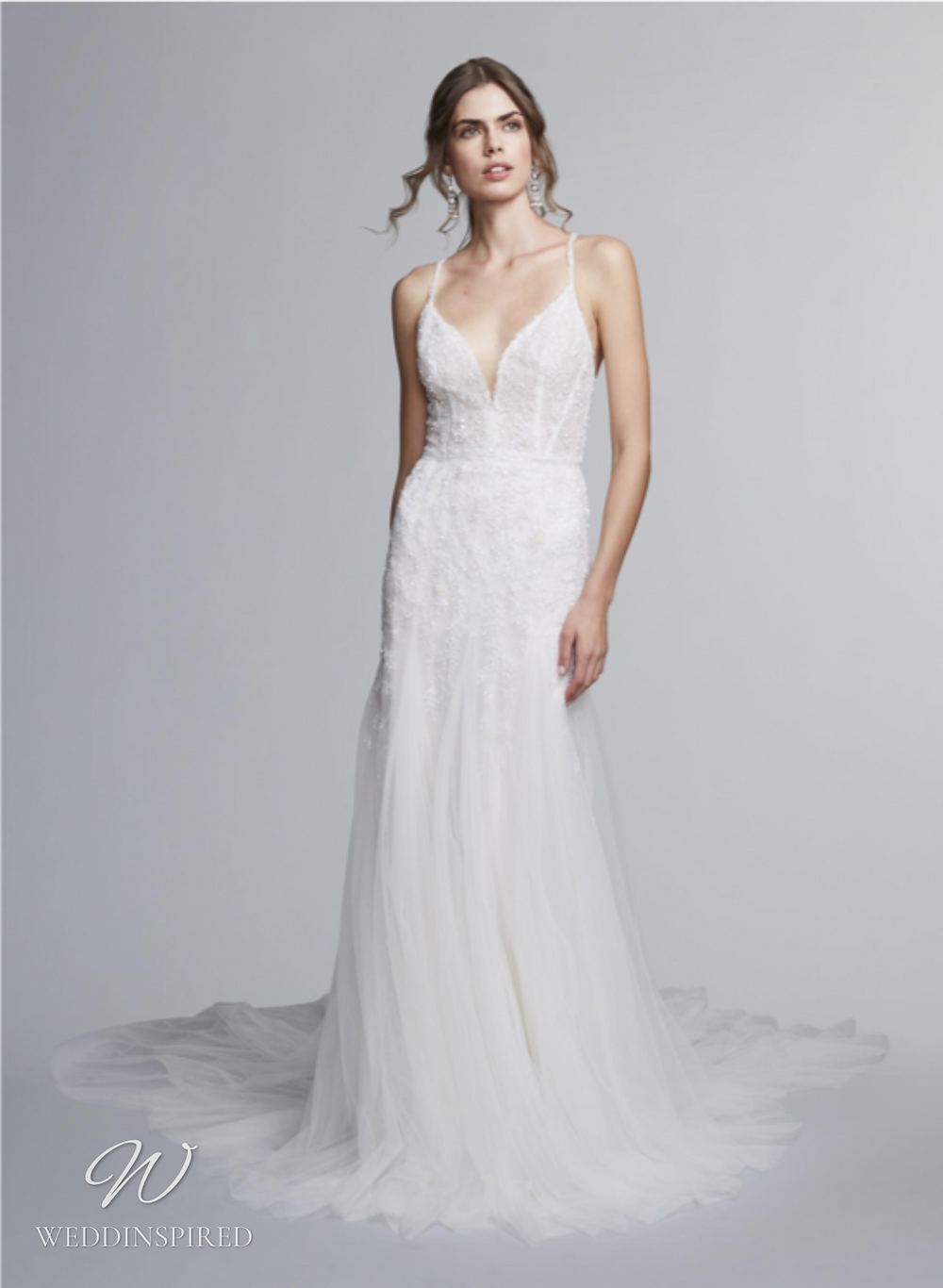 A Marchesa Notte Fall 2021 lace and tulle sheath wedding dress with straps and a v neck