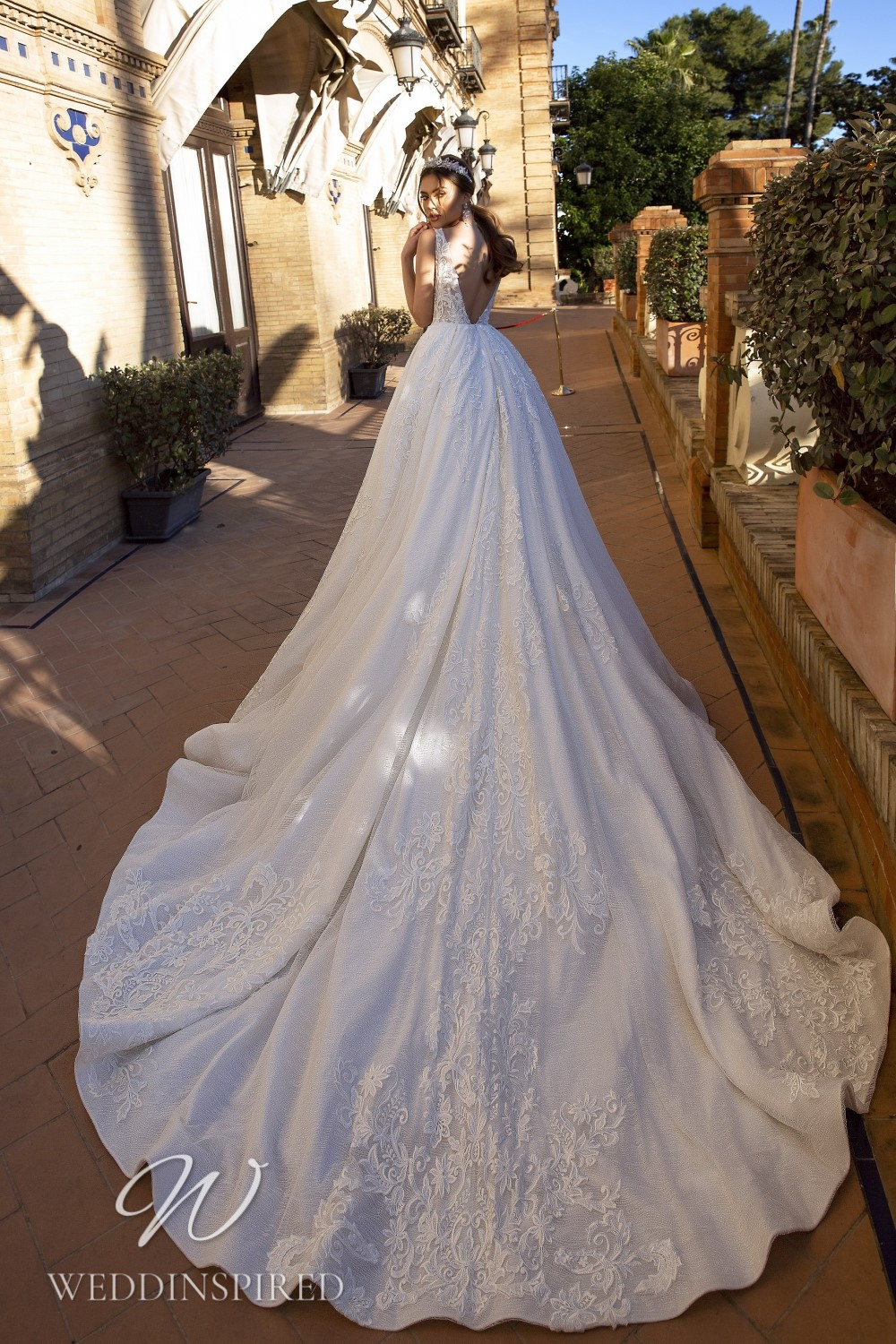 A Maks Mariano lace princess wedding dress with a low back