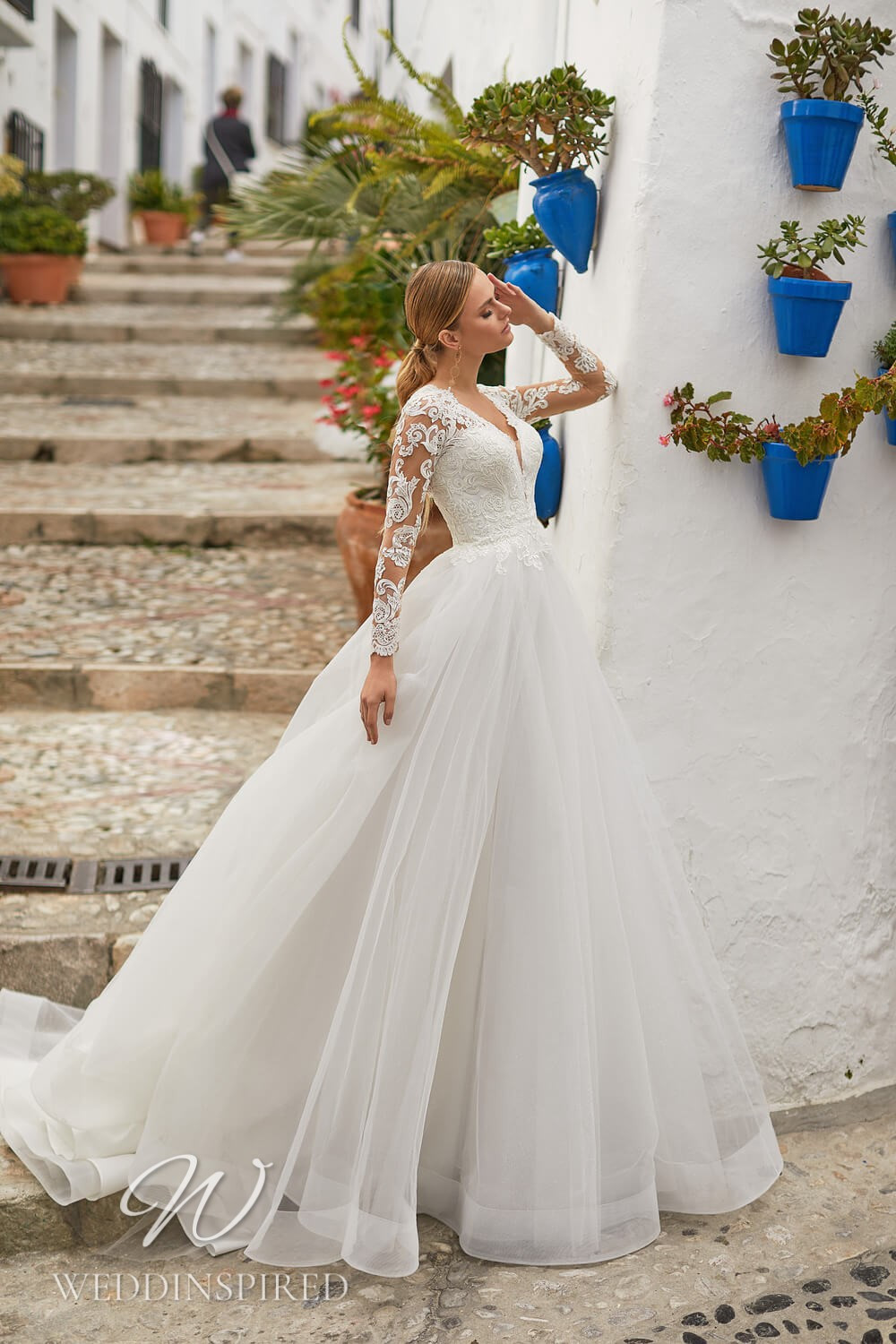 An Essential by Lussano 2021 lace and tulle princess wedding dress with long sleeves