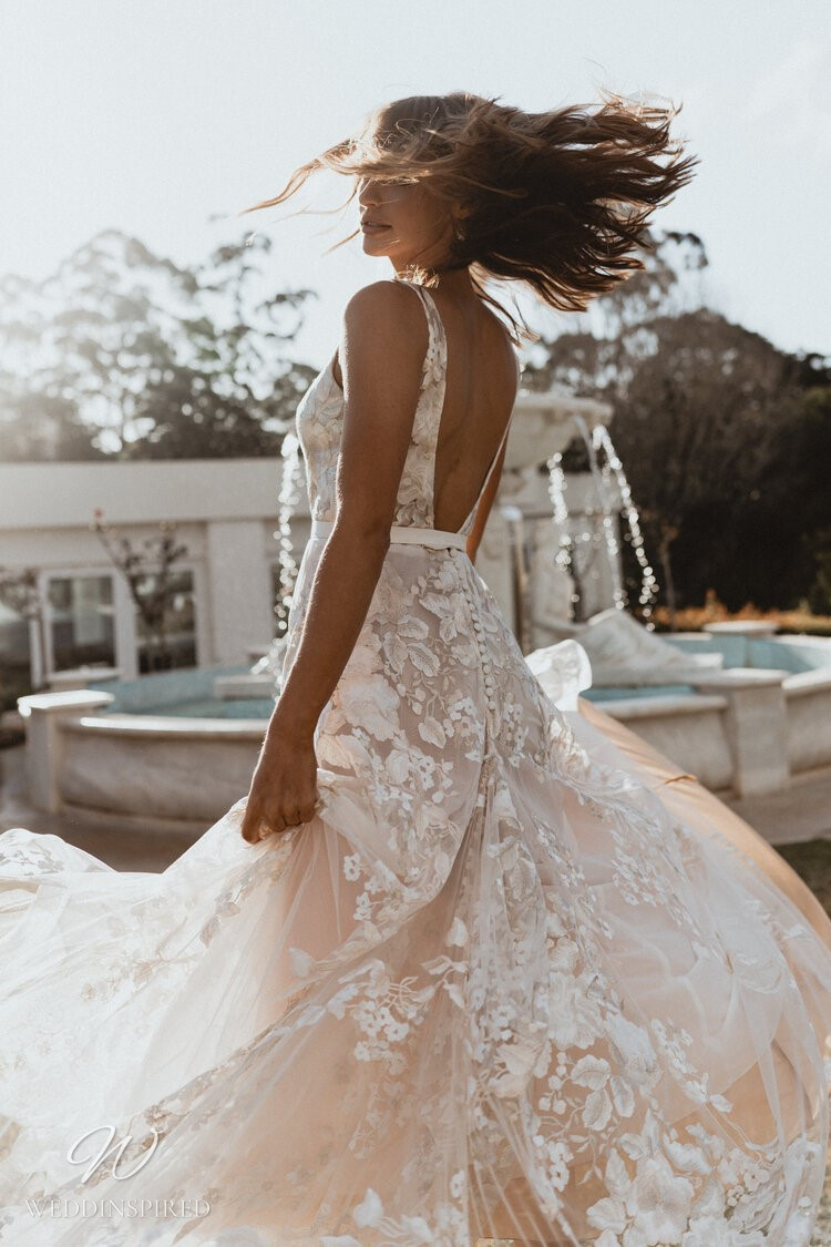 An Anna Campbell 2020 blush princess ball gown wedding dress with lace and straps