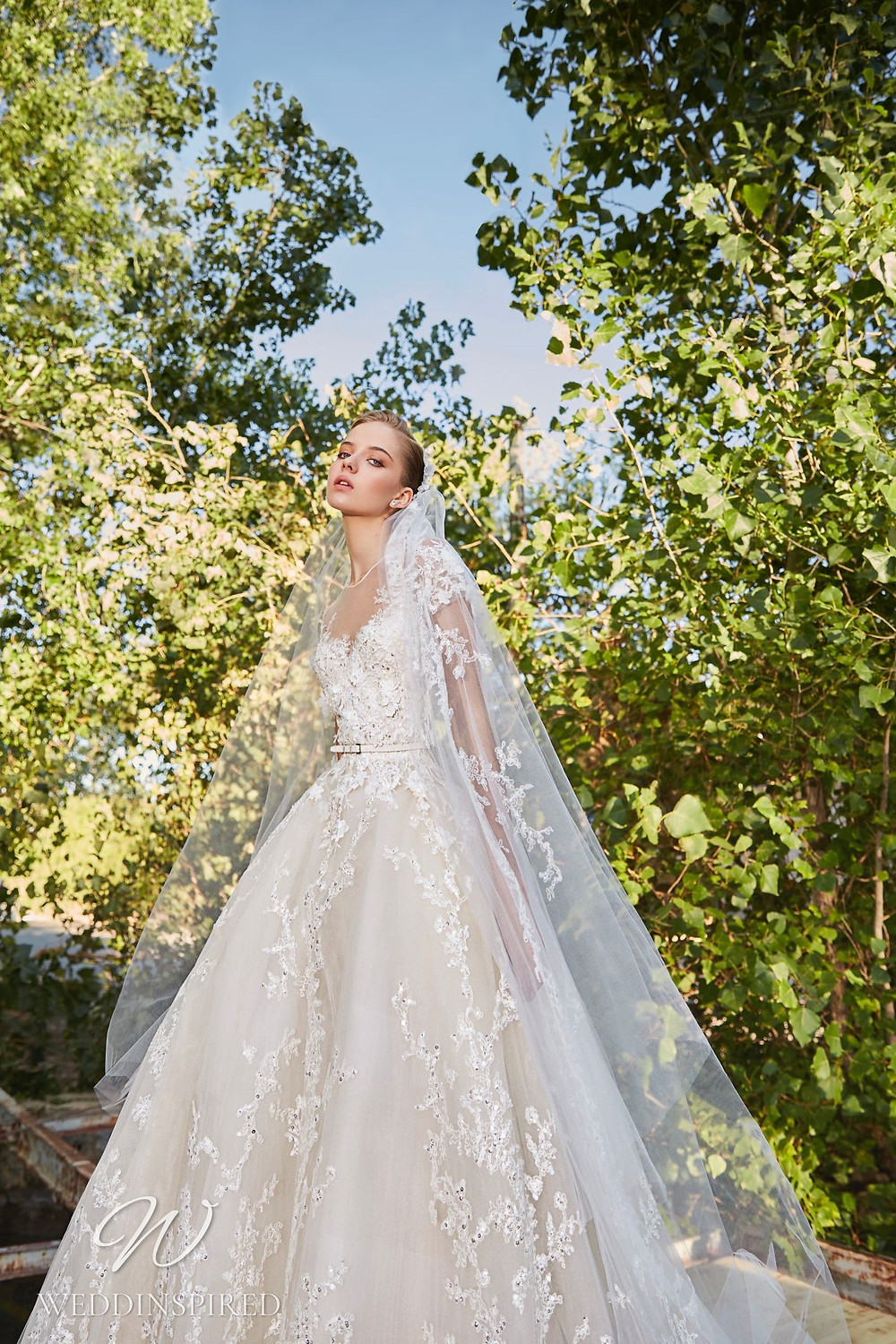 An Elie Saab Spring 2021 lace princess ball gown wedding dress with cap sleeves