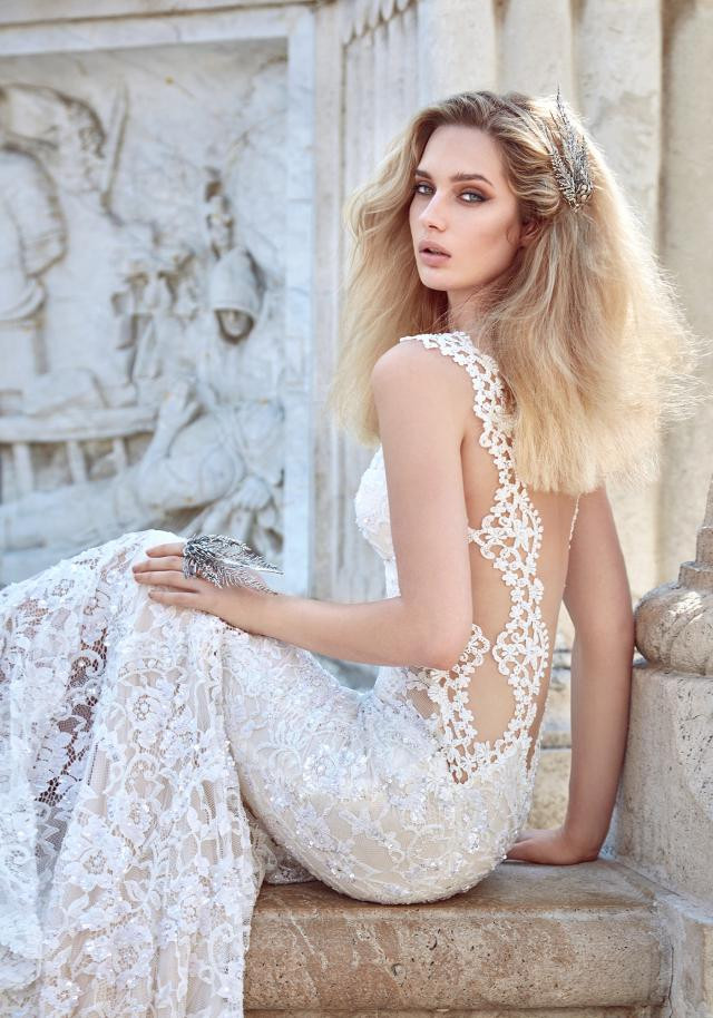 A Galia Lahav sexy lace mermaid fit and flare wedding dress with a low back