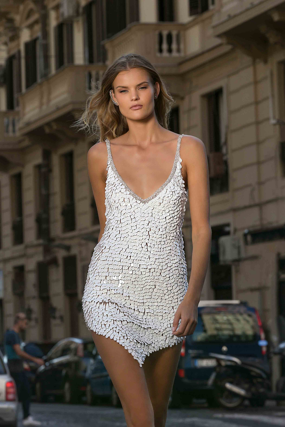 A short wedding dress with thin straps, a low v neckline and sequins