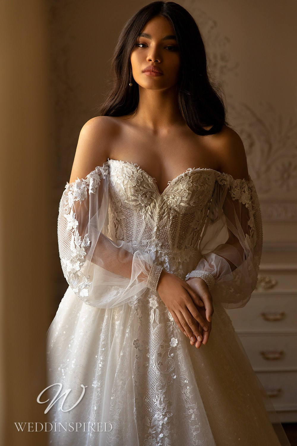 A WONÁ Concept 2021 lace and tulle off the shoulder princess wedding dress