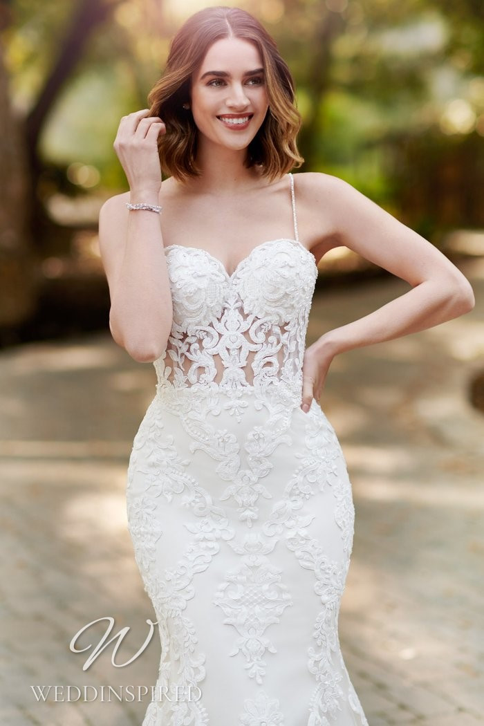 A Kenneth Winston 2021 lace mermaid wedding dress with straps