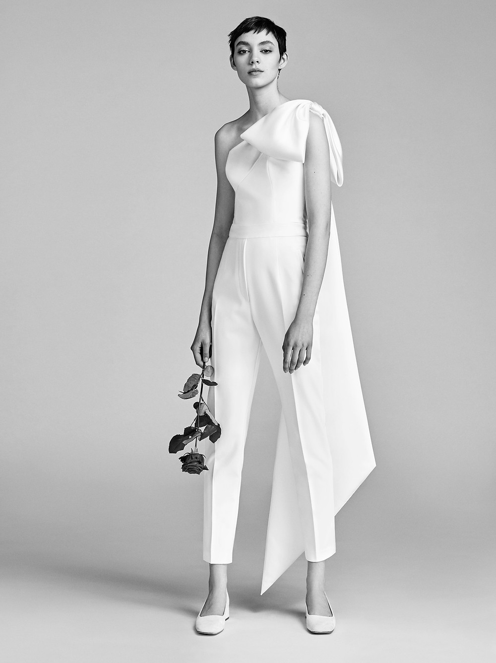 A Viktor & Rolf one shoulder simple linen wedding jumpsuit or pantsuit with a bow