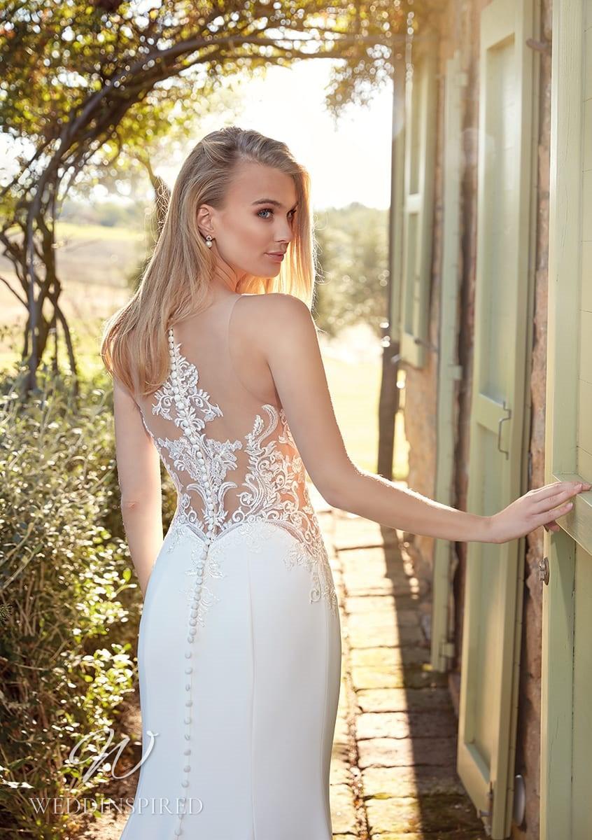 An Eddy K 2021 lace and satin mermaid wedding dress