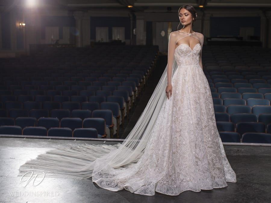 A Pronovias Privée 2021 strapless lace A-line wedding dress with a cape