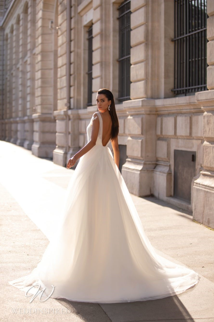 A Milla Nova tulle princess ball gown wedding dress with a low back and straps