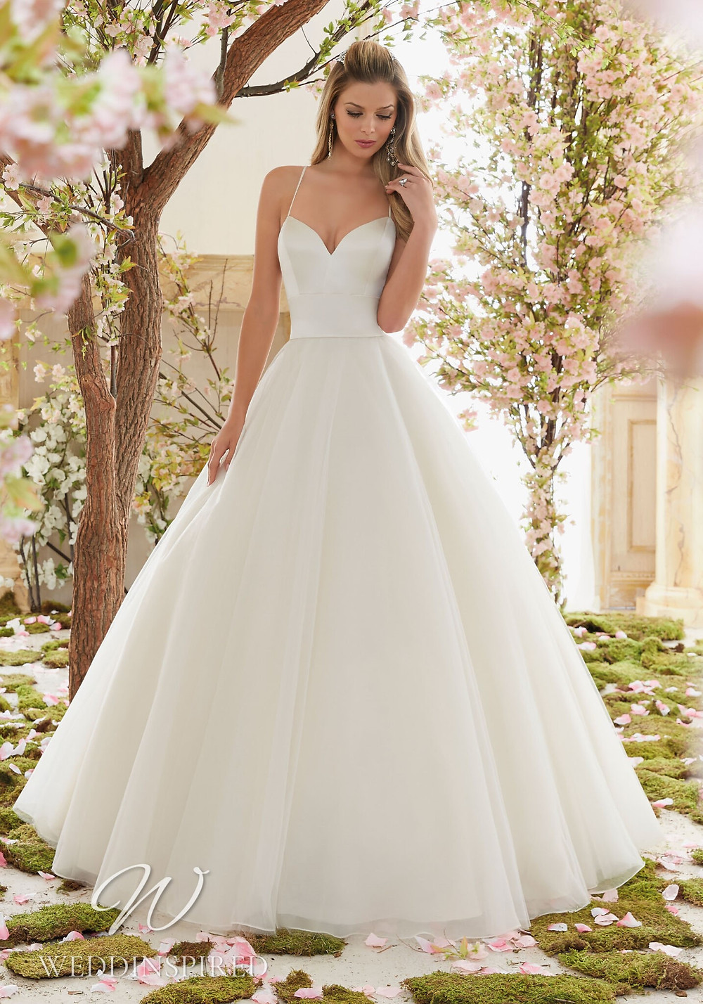 A Madeline Gardner satin and tulle princess ball gown wedding dress