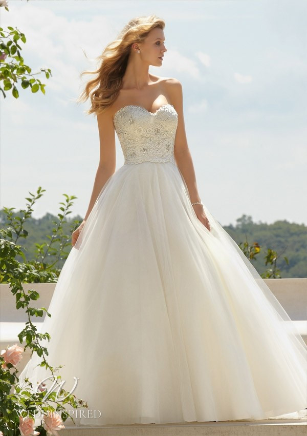 A Madeline Gardner strapless lace and tulle princess ball gown wedding dress