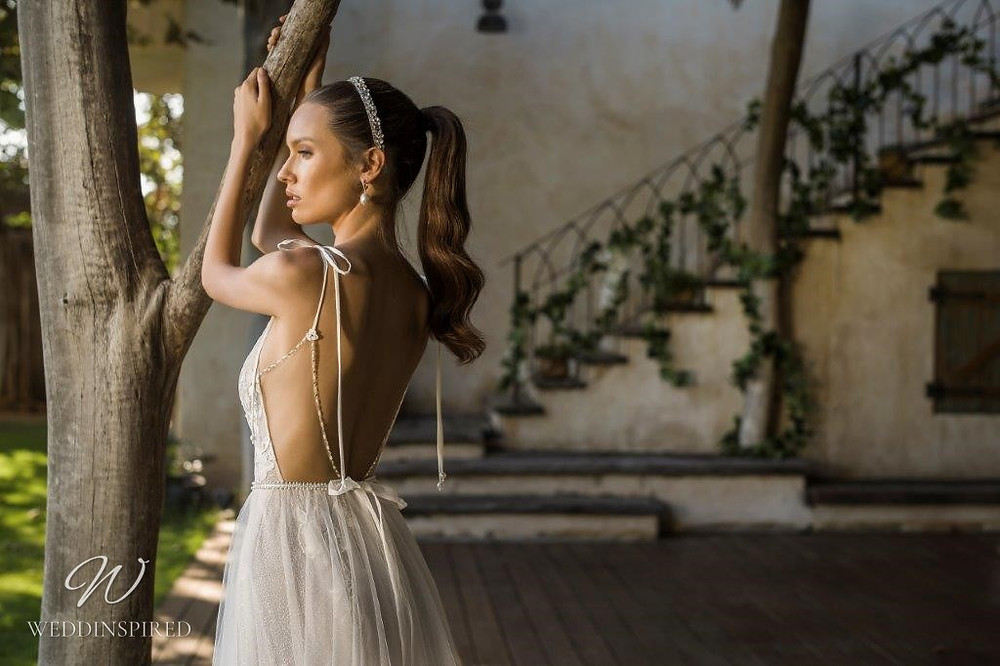 A David Hasbani lace and tulle A-line wedding dress with a v neckline