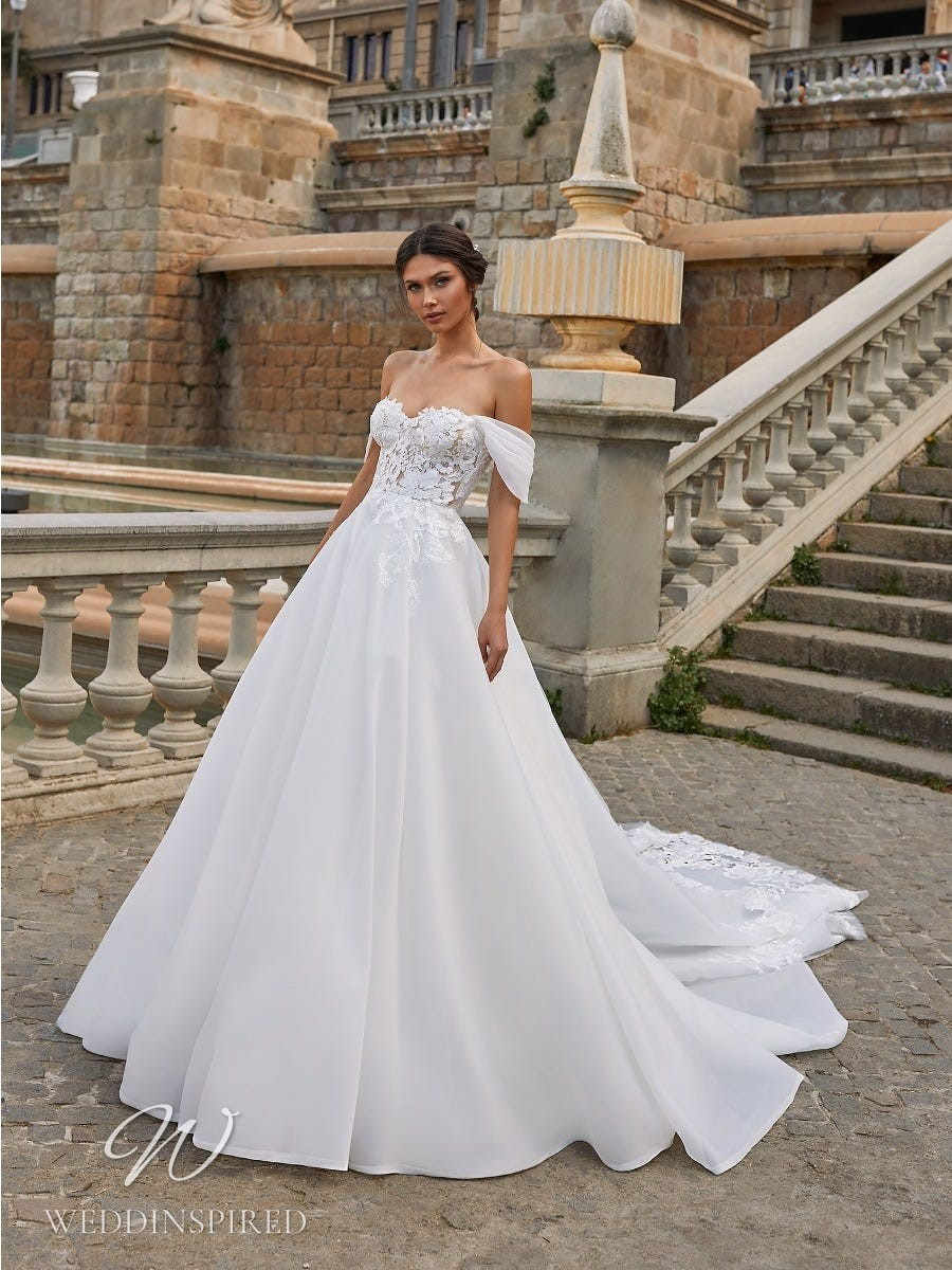 A Pronovias Privée 2021 off the shoulder lace and crepe princess ball gown wedding dress with a train