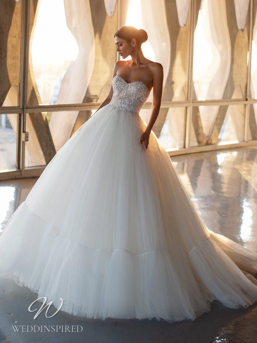 A Pronovias 2021 lace and tulle strapless princess ball gown wedding dress