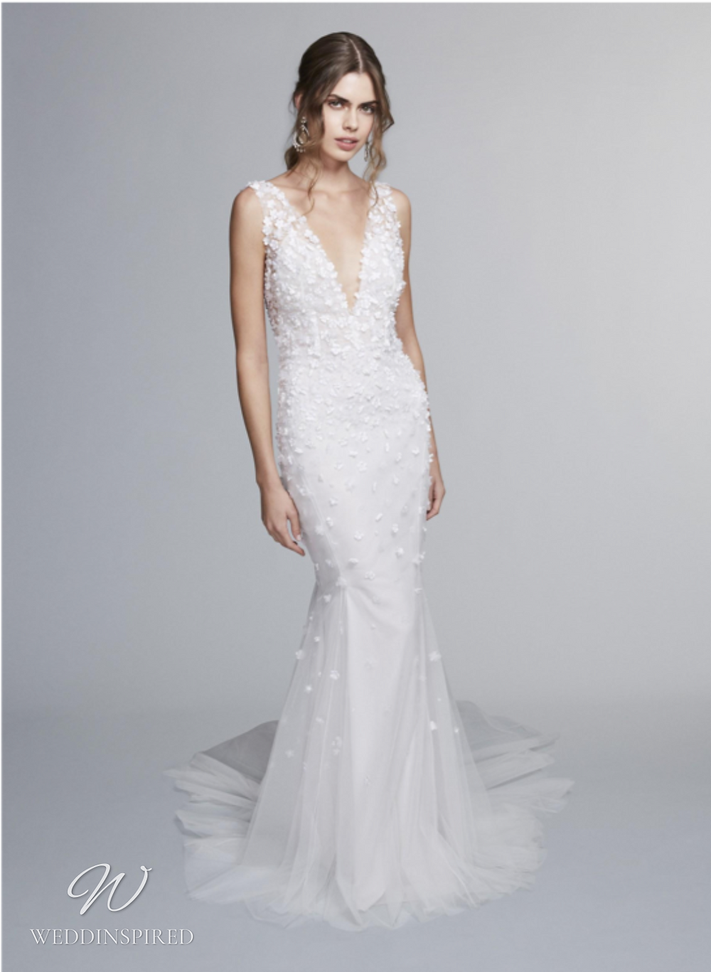 A Marchesa Notte Fall 2021 lace and tulle mermaid wedding dress with thick straps and a v neck