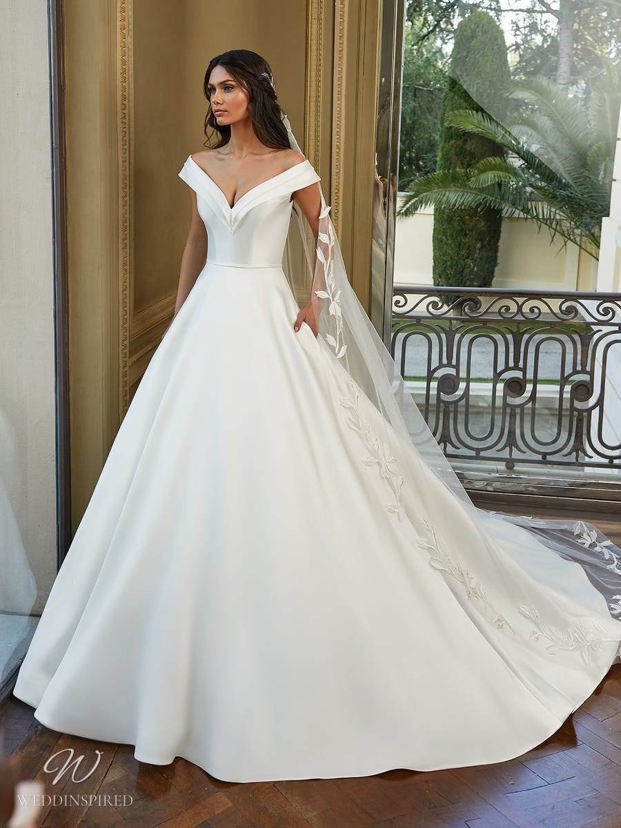 A Pronovias 2021 off the shoulder silk ball gown wedding dress with pockets