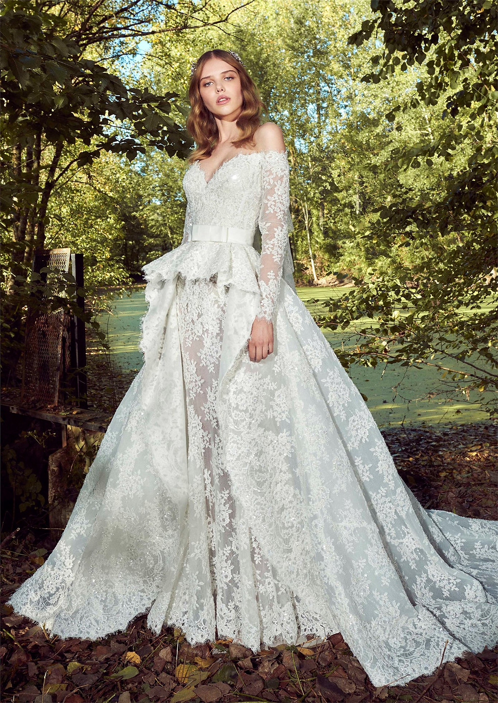 An off the shoulder, lace, ball gown wedding dress, with detachable skirt and long sleeves