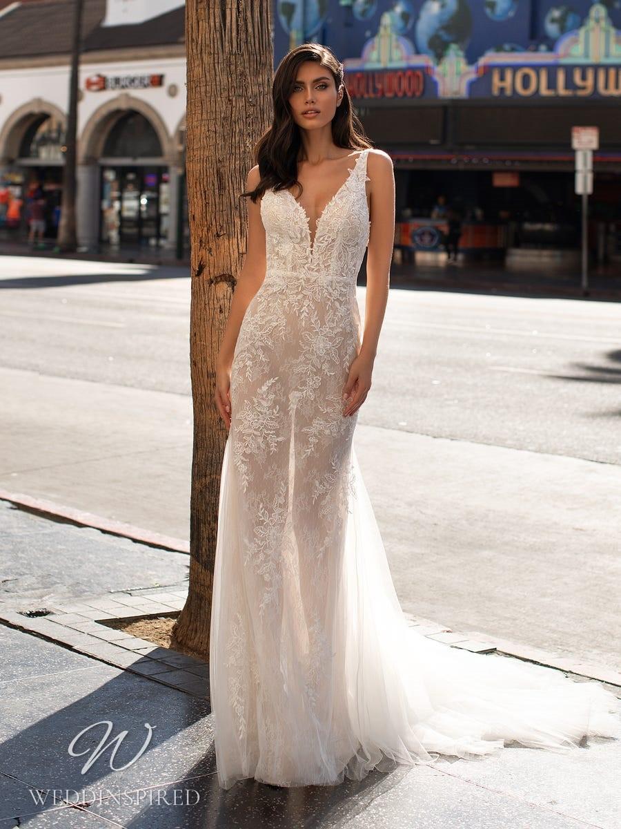 A Pronovias 2021 lace A-line wedding dress with straps and a v neck