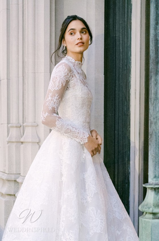 A Monique Lhuillier Fall 2021 modest lace and tulle vintage A-line wedding dress with long sleeves and a high neckline