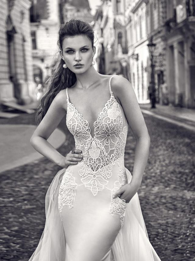 A Galia Lahav silk and lace mermaid wedding dress with a detachable skirt and pockets