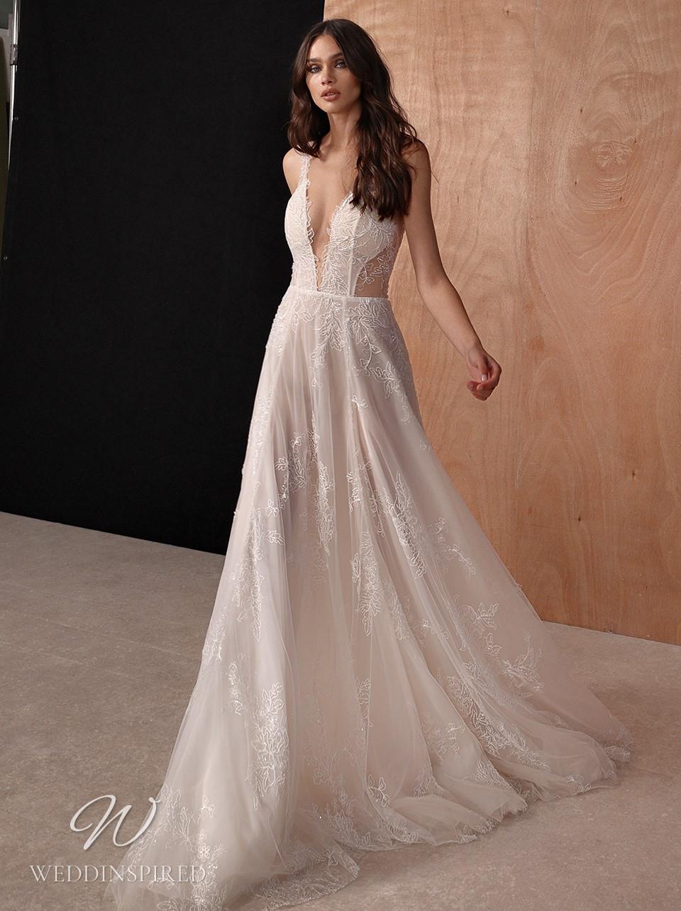 A Galia Lahav 2022 lace A-line wedding dress with a v neck