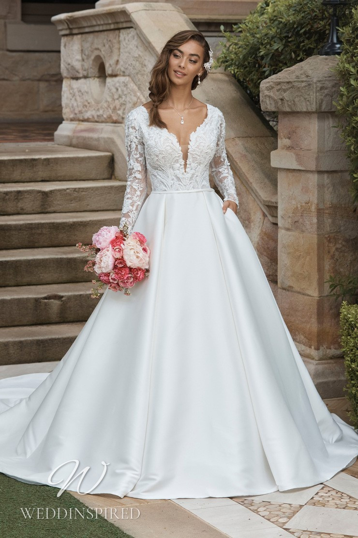 A Sophia Tolli 2021 lace and satin princess wedding dress with long sleeves