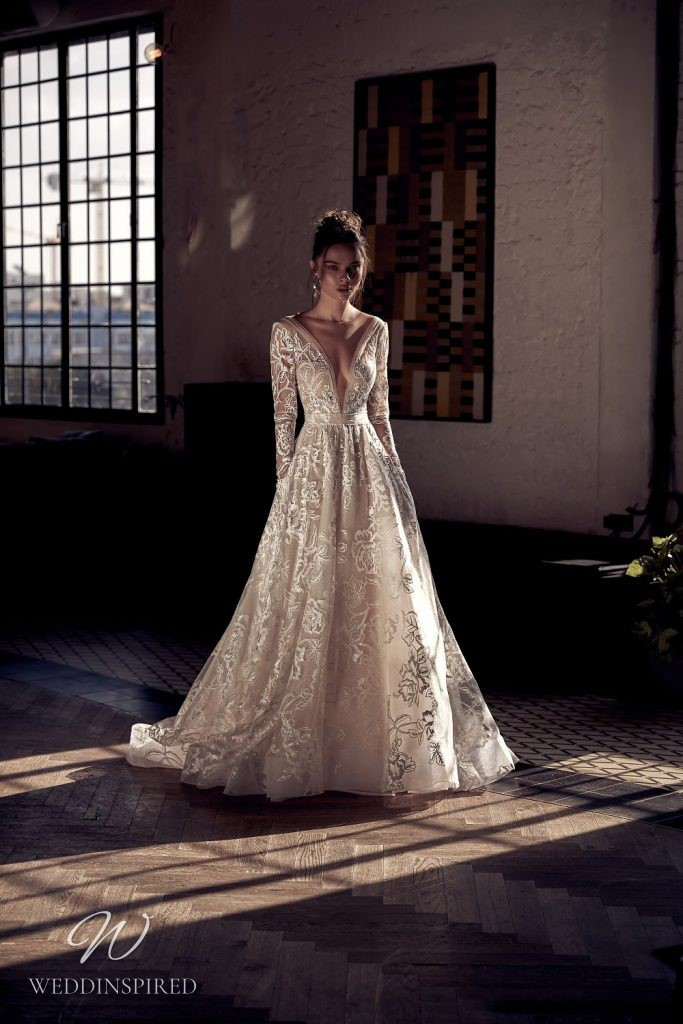 A Julie Vino 2021 blush floral tulle A-line wedding dress with long sleeves