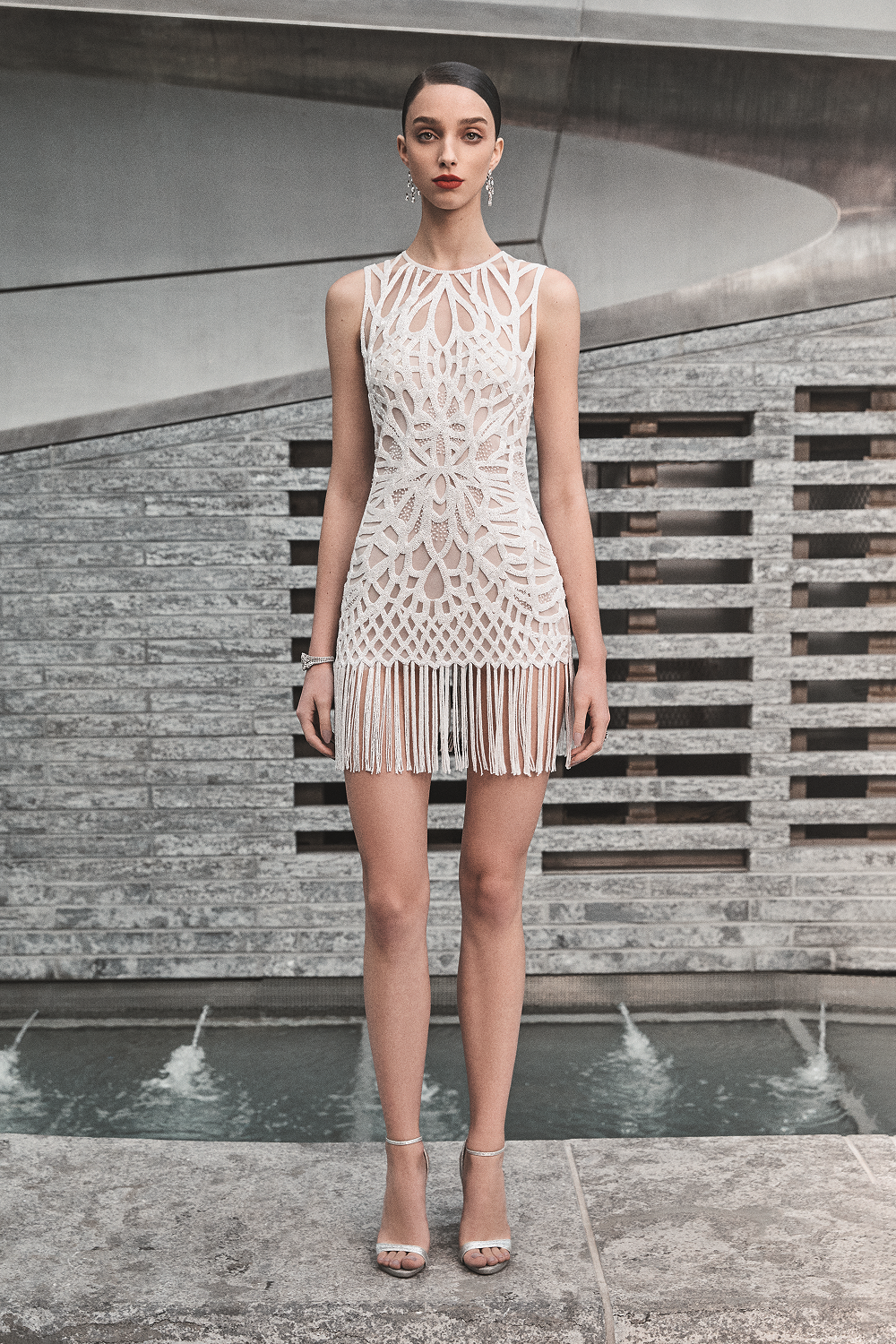 A Naeem Khan short pattern wedding dress with fringe