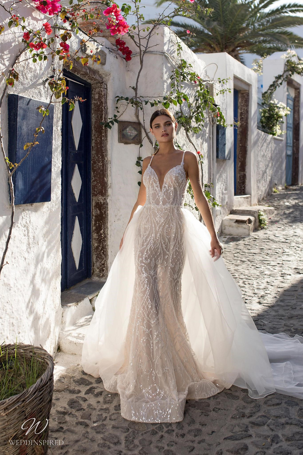 A Ricca Sposa sparkly mermaid wedding dress with a tulle detachable skirt, straps and crystals