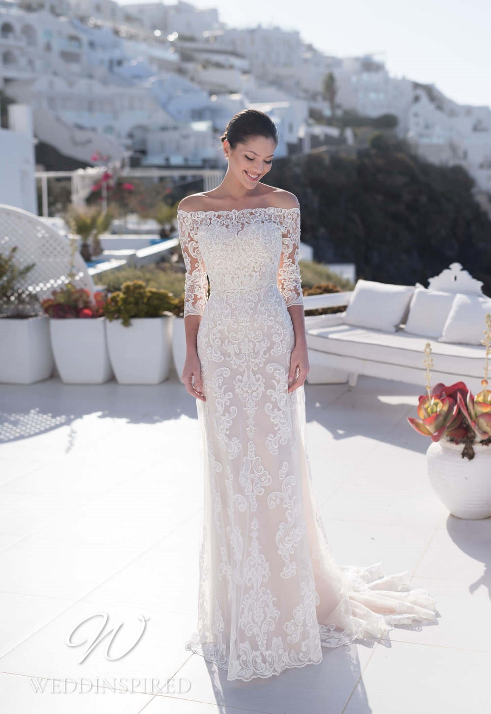 A Blunny 2021 off the shoulder lace sheath wedding dress with 3/4 sleeves