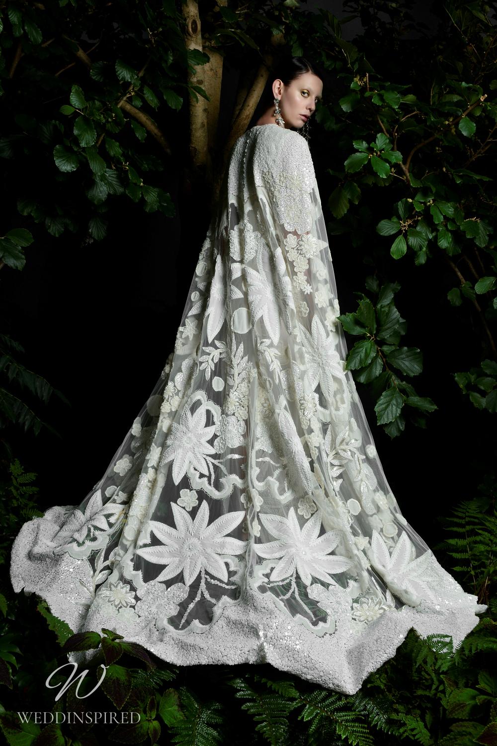 A Naeem Khan Fall 2021 bold floral wedding cape
