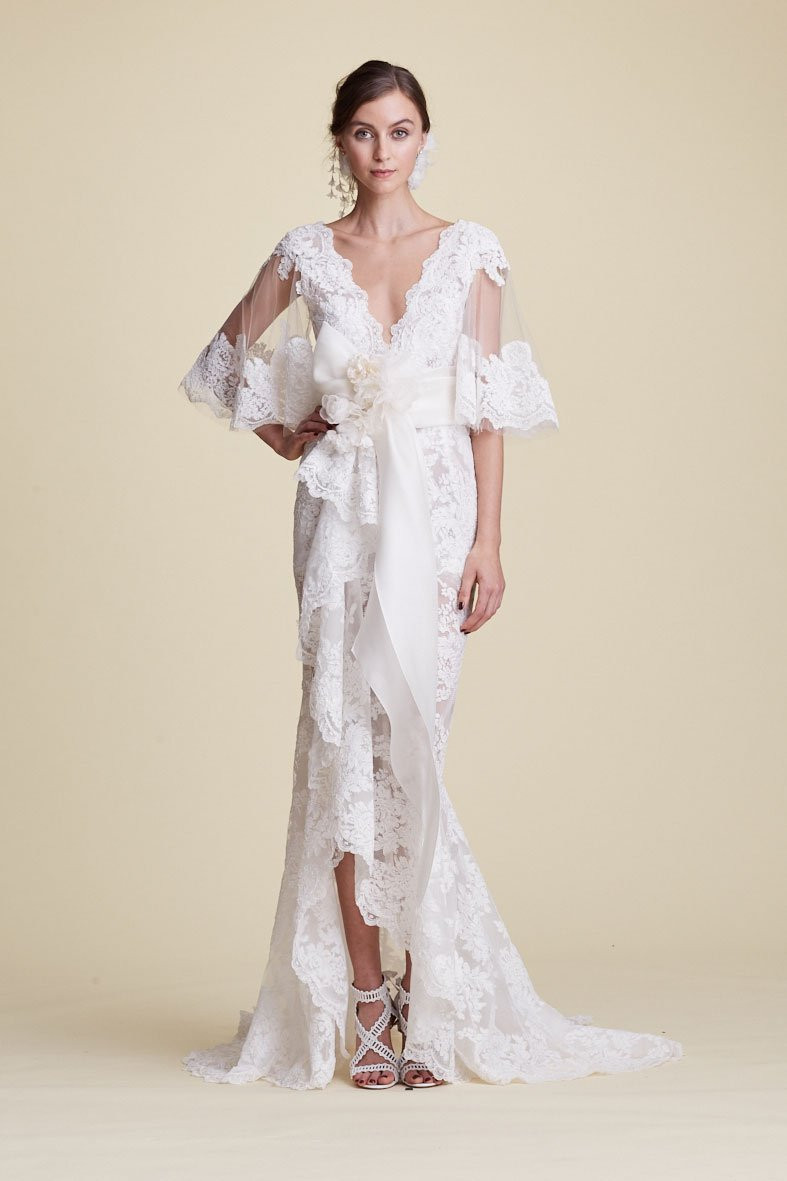A Marchesa vintage lace mermaid fit and flare wedding dress with a bow