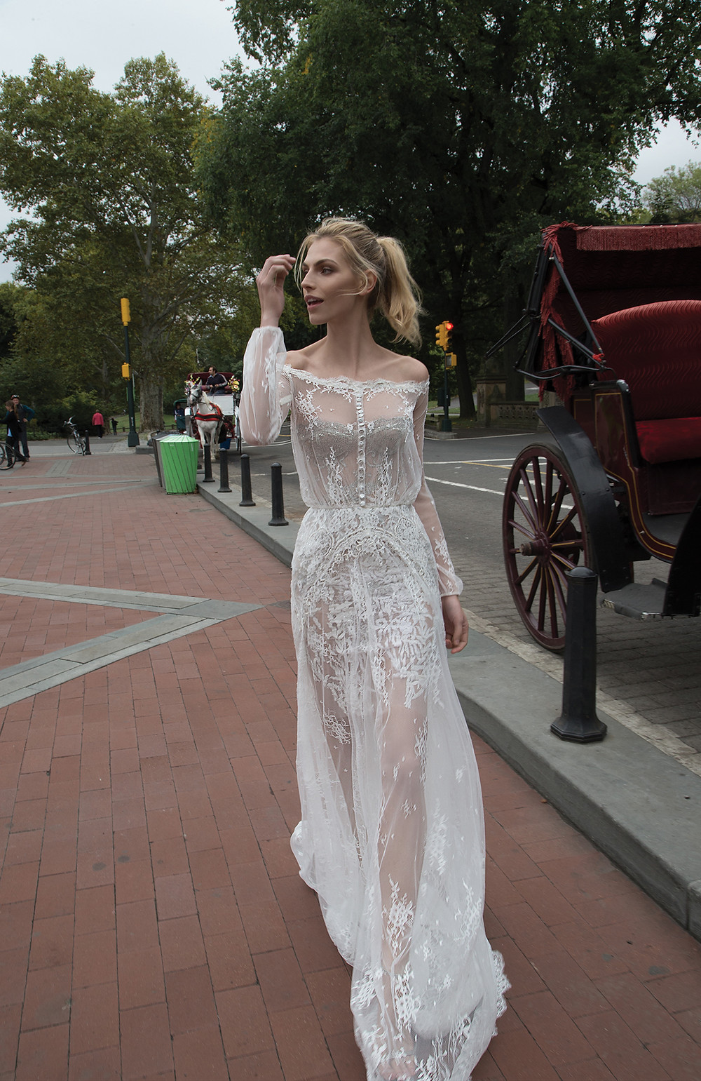 An off the shoulder tulle A-line wedding dress, with long sleeves and lace