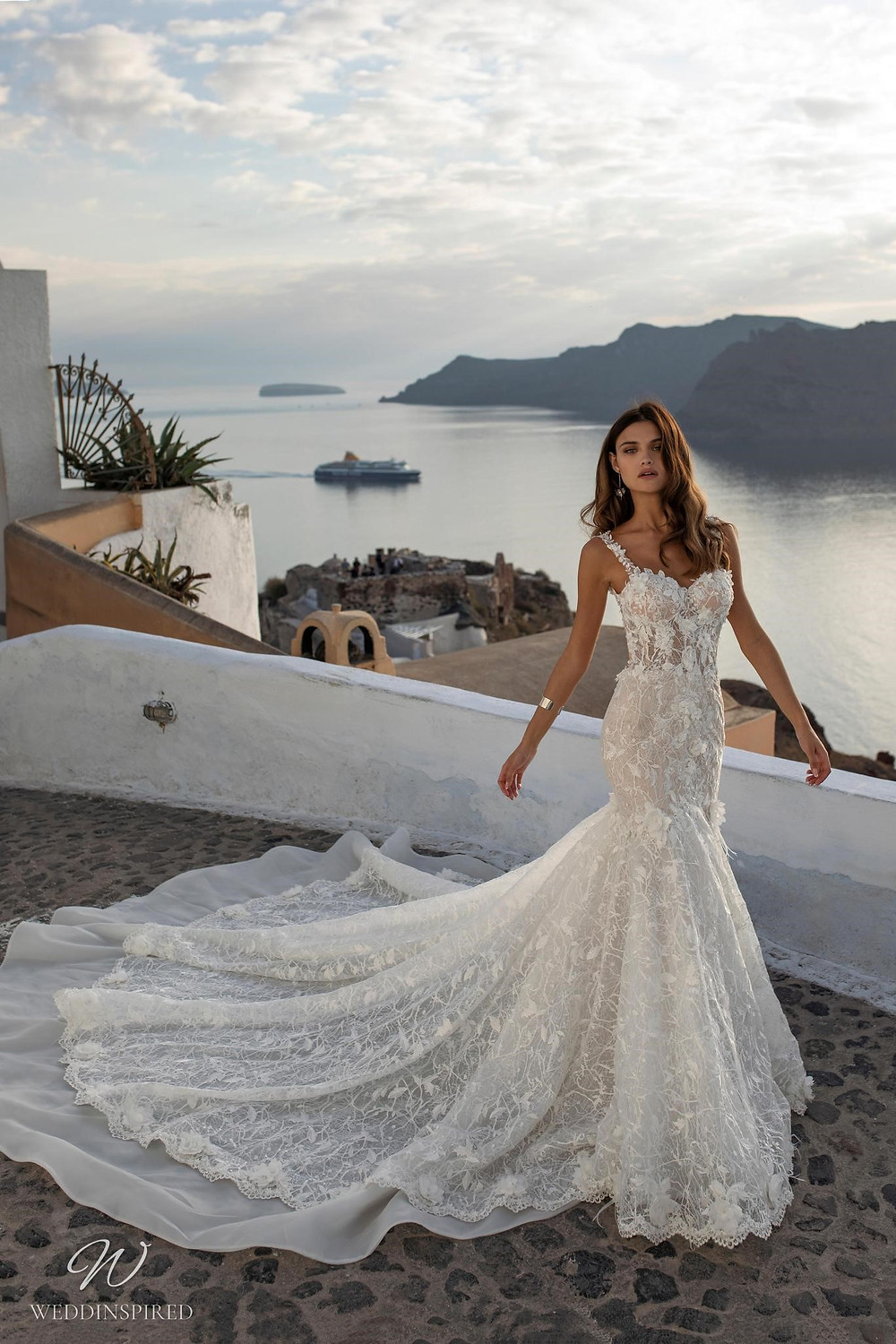A Ricca Sposa lace mermaid wedding dress with a sweetheart neckline, straps and a train